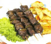 Souvlaki with ostrich meat and herbs