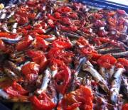 Baked gavros in tomato sauce